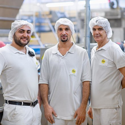 three Fortisa employees in the bakery